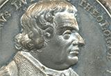 Porträt Luthers auf einer Gedenkmünze aus dem Jahr 1717